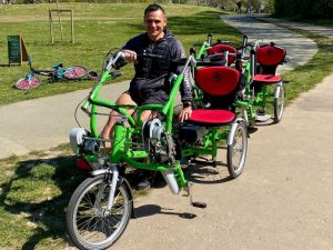 A cyclist on one of Cycall's adaptive bikes