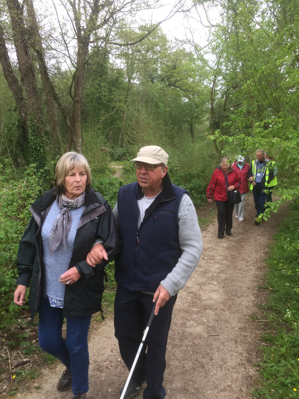 Photo of Barrie Smith and Frances Jacobs walking in Clapham Woods