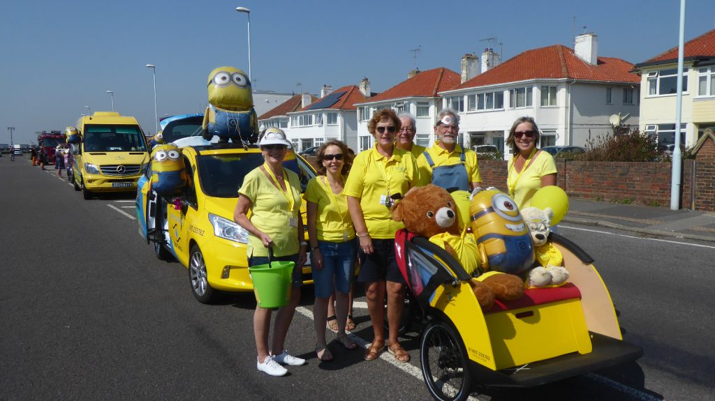 group of SSW staff and volunteers dressed up in a parade